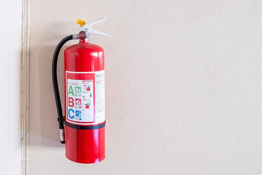 Extincteur d'incendies avec designation A, B et C