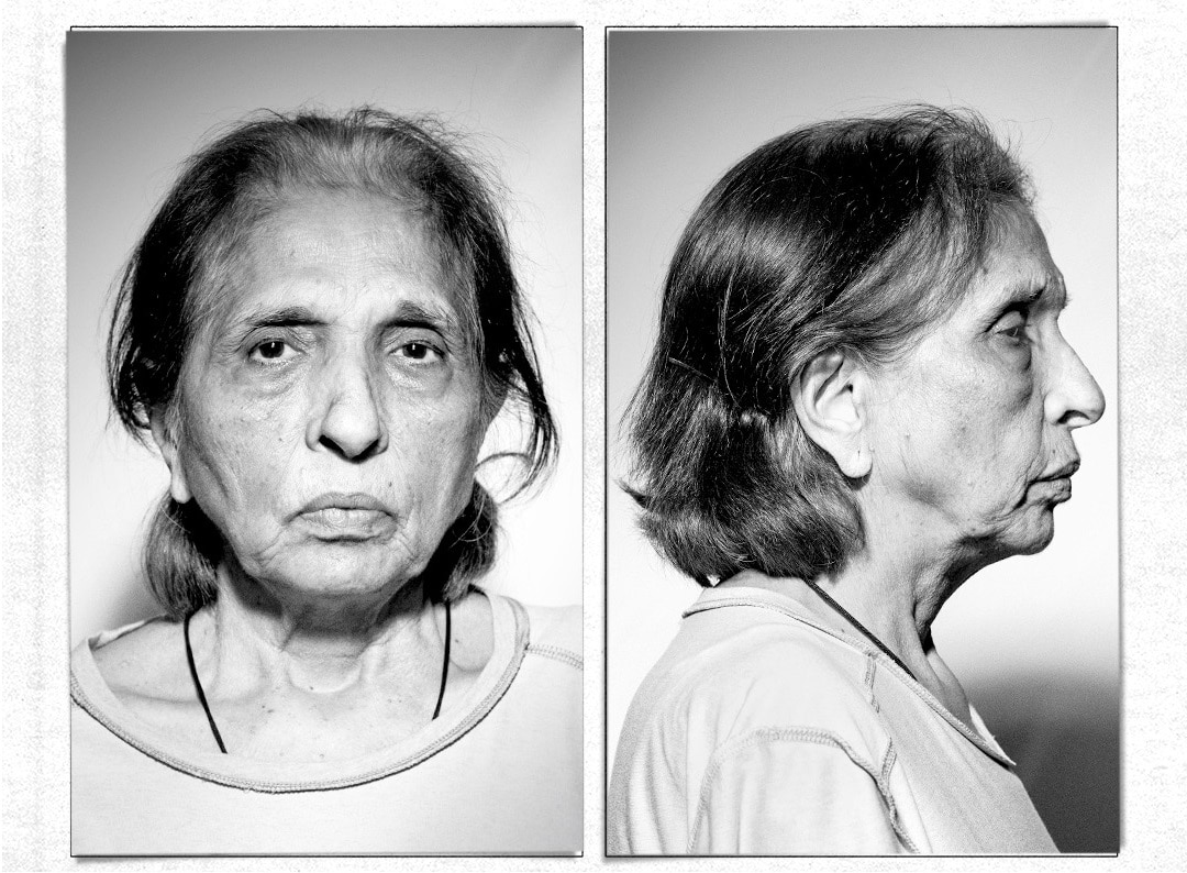 senior woman in mugshot style photo
